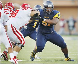 Whitmer High School's Marquise Moore (91) will ply his talents for the University of Toledo after he signs his national letter of intent after 7 a.m. today.