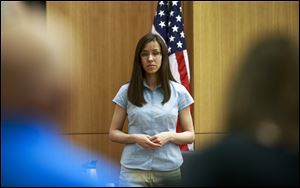 Defendant Jodi Arias takes the stand before testifying during her murder trial in Superior Court in Phoenix. Arias is accused of murdering her lover, Travis Alexander.