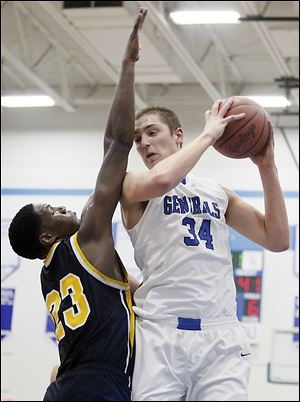Anthony Wayne's Mark Donnal tries to get around Whitmer's Nigel Hayes during a nonconference game on Tuesday night at Anthony Wayne High School. Donnal scored 15 points and grabbed 10 rebounds, while his future Big Ten rival scored 16 and hauled down seven boards.