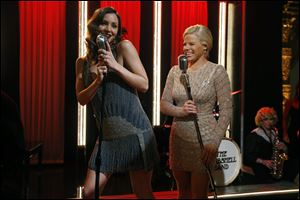 Katharine McPhee, left, and Megan Hilty and rest of the cast of