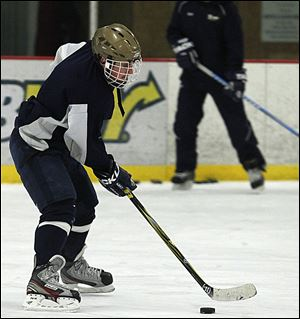 Austin Kelly, a senior forward, leads the Titans in goals (24) and assists (41). St. John's (23-7-0) won the Northwest Hockey Conference Red Division title.