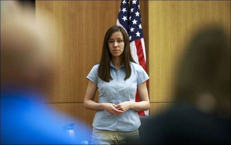 Defendant Jodi Arias takes the stand before testifying during her ...