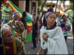 Bob Marley''s granddaughter Donisha Prendergast, right, dances to the sound of a Rastafarian drum, during the celebration of Marley's 68th birthday today in the yard of his Kingston home, in Jamaica.