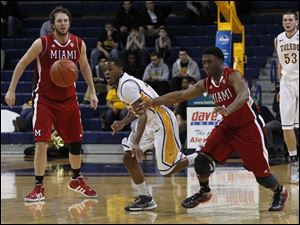 Toledo's Julius Brown steals the ball from Miami's Reggie Johnson.