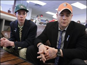 Drew Savage, left, and Jake Nachtrab, seniors at St. John's Jesuit High School in Toledo, talk about their friend and former classmate, Brian Hoeflinger, following a National Signing Day event. Savage will attend Ohio University and run cross country. Nachtrab will attend Bowling Green State University as a preferred walk-on on the football team.