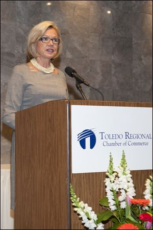Morgan Ballas speaks as she accepts the Athena award at the Toledo Regional Chamber of Commerce annual meeting.