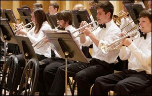 Trumpet players of the Toledo Youth Orchestra prepare for a concert.