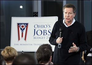 Gov. John Kasich speaks in Maumee. Wednesday's visit was Mr. Kasich's second stop on a road tour to tout his budget proposal.