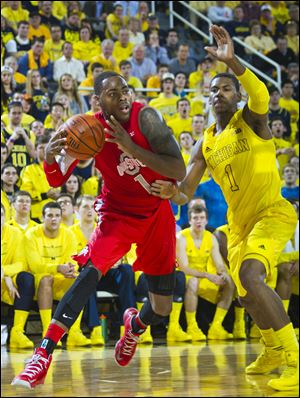 Ohio State forward Deshaun Thomas moves against Michigan forward Glenn Robinson III.