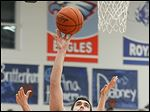 Lake's Marcus Pierce (54) takes a shot against  Otsego's John Thomas (44) and Ryan Smoyer (23) during Thursday's contest at Lake High School. Pierce scored 14 in the win.
