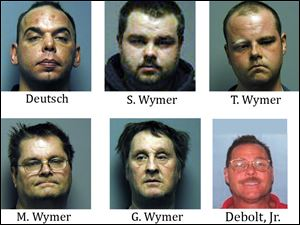 Michael Deutsch, 37; Shawn Wymer, 27; Terrance Wymer, 28; Mike Wymer, 54; and Gary Wymer, 55, were arrested and charged with transportation of stolen property, according to the FBI. An arrest warrant with the same charge was also issued for Robert Debolt, Jr., 47.