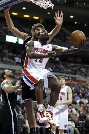Detroit Pistons point guard Will Bynum drives on Brooklyn Nets center Brook Lopez on Wednesday in Auburn Hills, Mich.