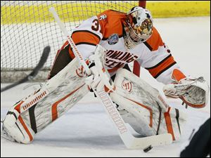 Bowling Green State University goalie Tommy Burke (31) blocks a shot  against Michigan State.