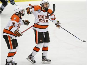 Bowling Green State University center Ryan Carpenter (22) celebrates scoring a goal against Michigan State with teammate Chad Sumsion (16).