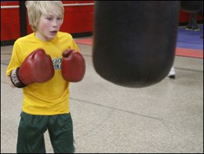Lucas Weirich, 13, takes a breather after a few punches.