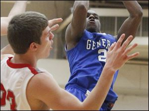 Anthony Wayne's senior Ose Omofoma (22) puts up two from inside the paint.
