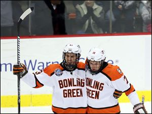 Bowling Green State University left wing Ben Murphy (17), right, celebrates scoring a goal against Michigan State with teammate Connor Kucera (3).