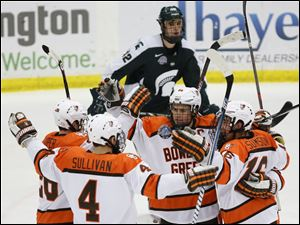 Bowling Green State University center Ryan Carpenter (22), center,  celebrates scoring a goal against Michigan State.