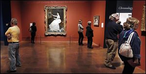 Art enthusiasts enjoy the last day of the popular Manet exhibit at the Toledo Museum of Art on Jan. 1.