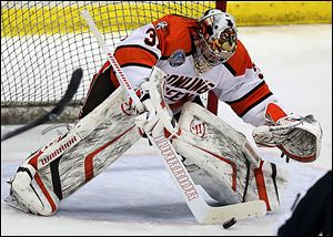Bowling Green goalie Tommy Burke blocks a shot  against Michigan State. The Falcons' netminder finished with 17 saves in a 2-1 win.