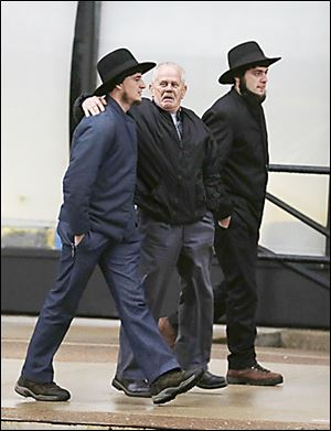 Amish men walk to the U.S. Federal Courthouse in Cleveland. Nine men and  six women were sentenced on Friday.