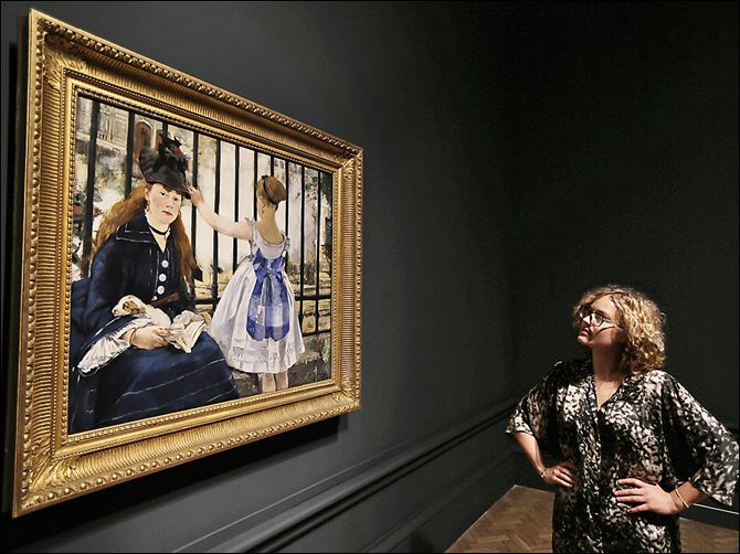 employee examines Manet A Royal Academy of Arts employee examines Manet's 'The Railway, 1873' at the gallery in  London.