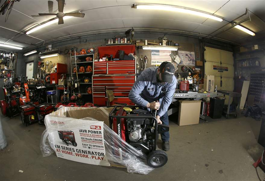 Chris-Oppenberg-of-Andover-Small-Engine-Service-assembles