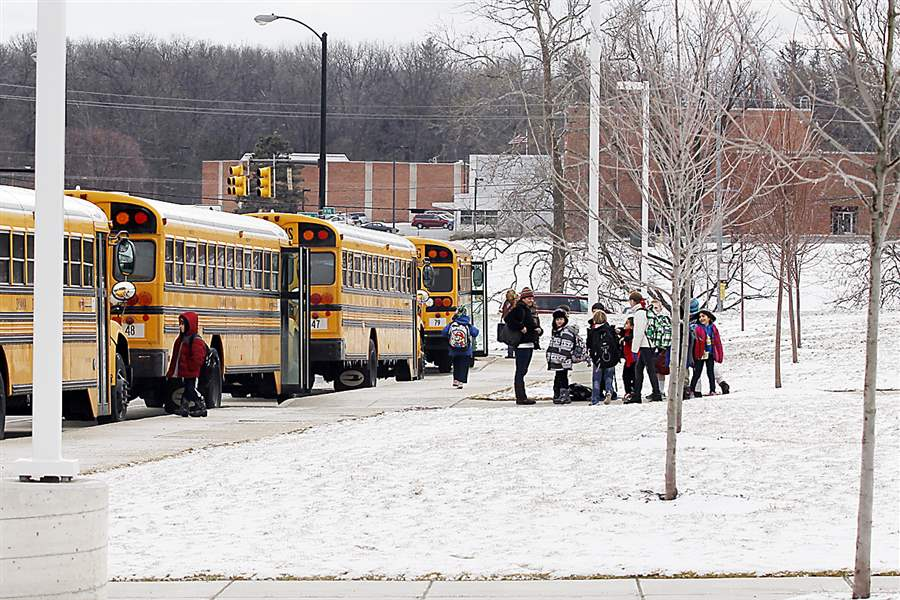 Sylvania-white-van-students-bus