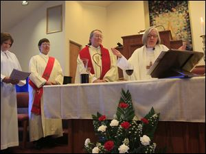 Rev. Sydney Condray, of Toledo, left; deacon Ann Klonowski,  Rev. Beverly Bingle, and Rev. Joan Houk, bishop, Roman Catholic Womenpriests Great Waters Region, during Mass.