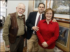 Wildlife artist Harold Roe, left, with Anthony and Janeen Esterson during an open house at their Eston's Bakery.