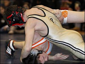 Perrysburg wrestler Leo Romp, top, turns Sylvania Southview's Kenan Newbold to his back on his way to pinning him during the final match at 126 pounds.
