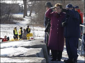 Congresswoman Marcy Kaptur is briefed by Coast Guard Capt. Andy Sugimoto, exercise director and chief of incident management on the Great Lakes.