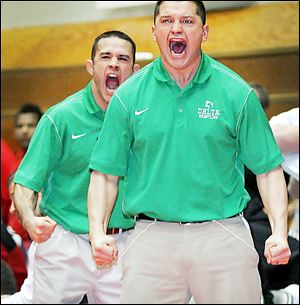 Delta coaches Anthony, left, and Danny Carrizales react to a pin during the team's semifinal match.