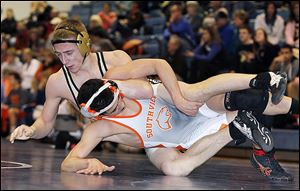 Perrysburg's Ryan Roth, top, controls Southview's Brendan Mulvaney during their 145-pound final match. Roth got the pin for his 122nd victory, which is a Perrysburg school record. Roth's title was one of nine individual titles for the Yellow Jackets.