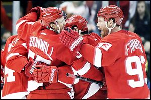 The Red Wings' Niklas Kronwall celebrates a goal with Johan Franzen (93) and other teammates in the third period against the Edmonton Oilers on Saturday.