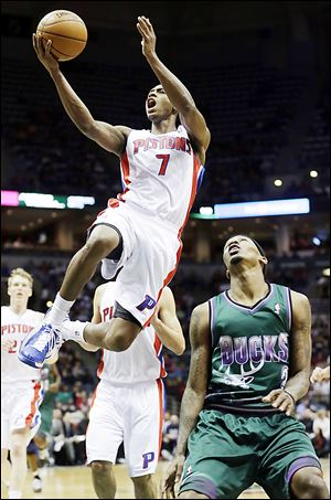 The Pistons' Brandon Knight shoots over Milwaukee's Brandon Jennings during the first half.