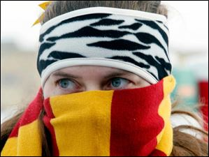 Becca Haidet, a member of the Toledo Firebolts  Quidditch team stays warm in between matches during The Glass City Quidditch Classic at Bowman Park.