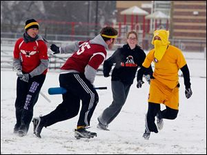 In yellow is the Snitch, Jacob Heppe of the Michigan State team,  evades players while they try to catch him.
