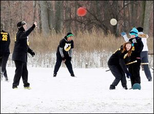 One of the many Quidditch teams warm-up during The Glass City Quidditch Classic.