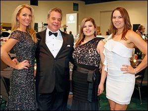 From left, Cori Rist, Mike Pauley, Natalie Pohorecki, and Kelly Isaac at the Toledo Auto Show Gala.