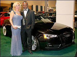 James and Nora Harris in front of a Audi A5.