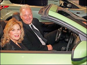 Judy McCracken and Eric Fankhauser sit inside a Ford Mustang at the 2013 Toledo Auto Show Gala Wednesday evening at the SeaGate Centre.