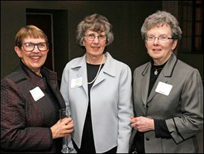 Huntington Bank vice president of Wealth Management Becky Breier, left, Carol Ardner, center, and Barb Heindel, right, at the 94th Toledo Area Artists Exhibition at the Toledo Museum of Art.