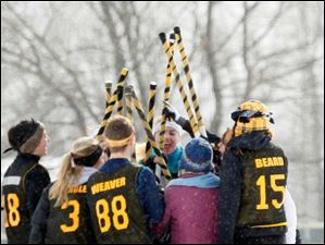The Wooster Quidditch team gets excited about their game.