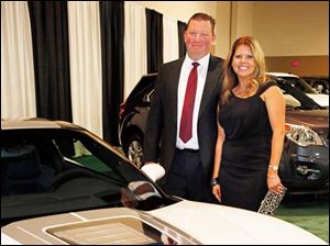 Greg and Amy Dunn next to the Corvette ZR.
