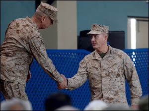 U.S. Marine Gen. Joseph F. Dunford, right, shakes hand with outgoing NATO commander U.S. Gen. John Allen, left, during a change of command ceremony at the ISAF headquarters in Kabul, Afghanistan, today. Dunford takes charge at a critical time for President Obama and the military as foreign combat forces prepare to withdraw by the end of 2014.