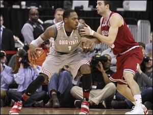 Ohio State's Deshaun Thomas, left, posts up against Indiana's Will Sheehy during the second half of an NCAA college basketball game in Columbus. Indiana defeated Ohio State 81-68.