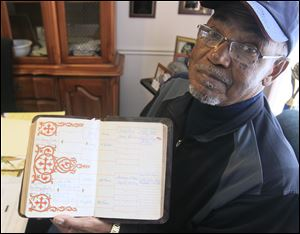 Ron Jackson shows his family Bible. The family tree was entered by his grandmother, Irene Jackson Leak, who married Warnie Leak in Napoleon in 1939.
