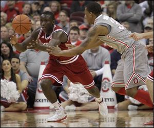 Indiana's Victor Oladipo, left, grabs a loose ball away from Ohio State's Lenzelle Smith. Oladipo scored a career-high 26 points.