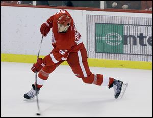 The Red Wings' Jonathan Ericsson shoots the game-winning goal during the third period against the Los Angeles Kings on Sunday at Joe Louis Arena. The shot trickled past L.A. goalie Jonathan Quick with 4.5 seconds remaining in the contest.